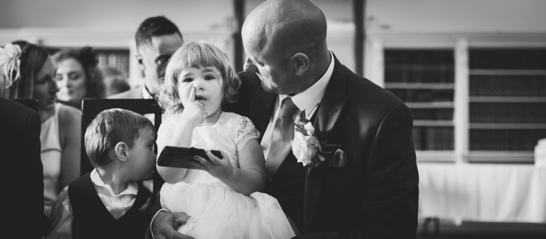 flower girl picking her nose